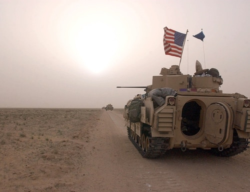 U.S. Army 3rd Division 3-7 Bradley fighting vehicles take up a position along a road March 19, 2003, inside the demilitarized zone between Kuwait and Iraq. (Scott Nelson/Getty Images)