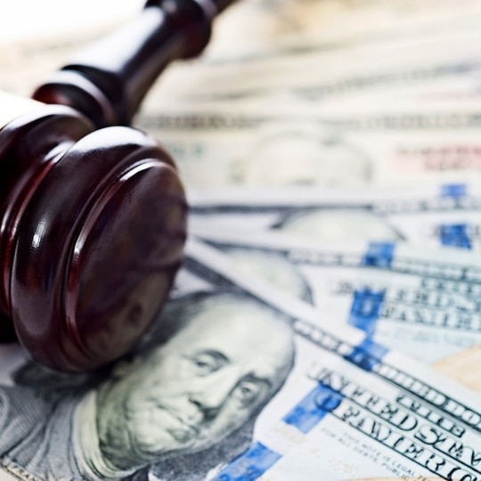 Under the proposed settlement, the online lender will pay any remaining restitution to service members. (baona/Getty Images)