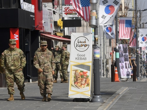 U.S. soldiers walk at a shopping zone outside Camp Humphreys in Pyeongtaek, South Korea, on Feb. 21, 2019. (Jung Yeon-je/AFP via Getty Images)