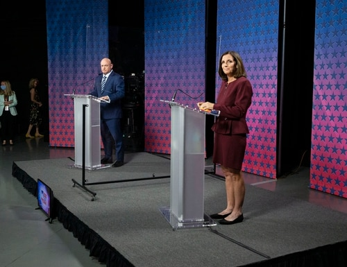 Democratic challenger Mark Kelly, left, and Arizona Republican Sen. Martha McSally -- both military veterans -- take part in a pre-election debate on Oct. 6, 2020, at the Walter Cronkite School of Journalism at Arizona State University in Phoenix. (Rob Schumacher/AP, Pool)