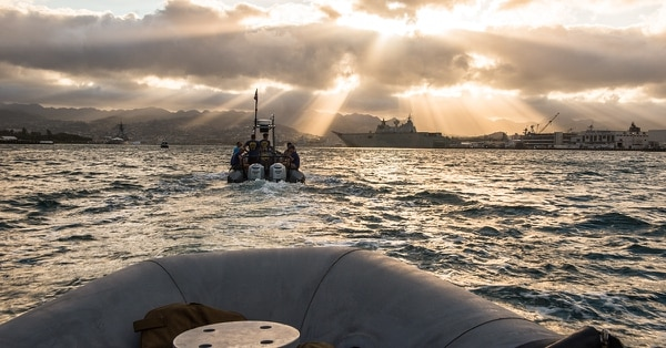Navy divers, assigned to Mobile Diving Salvage Unit (MDSU) 1, transit to the USS Arizona Memorial for a dive during the Rim of the Pacific (RIMPAC) 2018 exercise, July 7. (MC2 Daniel James Lanari/Navy)