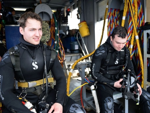 Navy Diver Third Class Thomas Parhiala Jr., left, and Navy Diver 3rd Class John McLeod, assigned to Naval Submarine Support Facility, pulled a motorist from a Maine pond while visiting McLeod's home near Rockport, Maine. (Mass Communication Specialist 1st Class Steven Hoskins/Navy)
