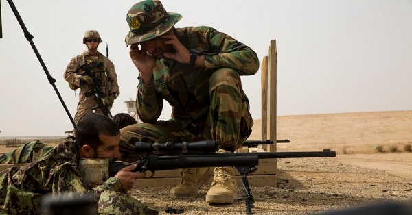 Afghan National Army 215th Corps soldiers assist one another with adjusting their weapons during a live-fire range at Camp Shorabak, Afghanistan, May 14, 2018. (Sgt. Luke Hoogendam/Marine Corps)