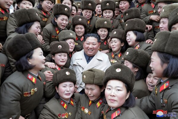 In this undated photo provided on Monday, Nov. 25, 2019, by the North Korean government, North Korean leader Kim Jong Un, center, poses as he inspects a women's company under Unit 5492 of the Korean People's Army in North Korea. I(Korean Central News Agency/Korea News Service via AP)