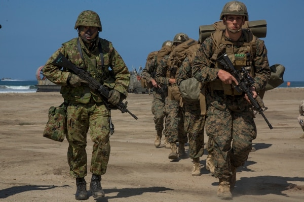 U.S. Marines and a Japanese Ground Self Defense Force solider offload a landing craft air cushion during Exercise Dawn Blitz 2015 at Marine Corps Base Camp Pendleton, Calif. on Sept. 5, 2015. Dawn Blitz is a multinational training exercise designed to enhance Expeditionary Strike Group Three and 1st Marine Expeditionary Brigade's ability to conduct sea-based operations, amphibious landings, and command and control capabilities alongside Japan, Mexico, and New Zealand. (U.S. Marine Corps photo by Sgt. Luis A. Vega, 1st Marine Division Combat Camera/Released)
