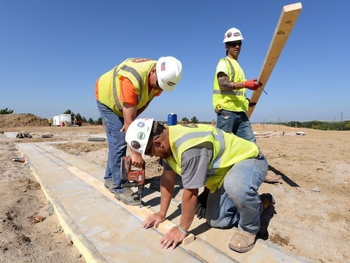 Carpenters work on a stem wall for the footing foundation of a new dormitory being built next to Tuskegee Hall at Offutt Air Force Base, Neb., on Aug. 17, 2017. The dormitory is scheduled for completion in February 2019. (Delanie Stafford/Air Force)