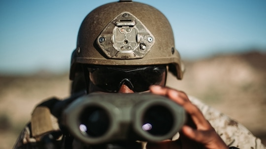 Lance Cpl. Deshawn Davidson ranges a target during exercise Summer Fury 20 in Yuma, Ariz., July 14, 2020. (Cpl. Jennessa Davey/Marine Corps)