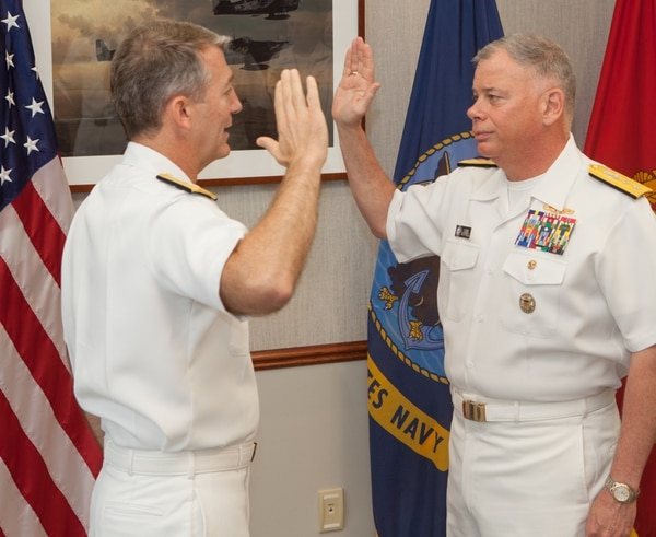 Rear Adm. John B. Nowell (right) is promoted to the rank of vice admiral by Rear Adm. Jamie Sands during a May 24 ceremony at the Midway Ceremonial Drill Hall at Naval Station Great Lakes. (Lt. Cmdr. Frederick Martin/Navy)
