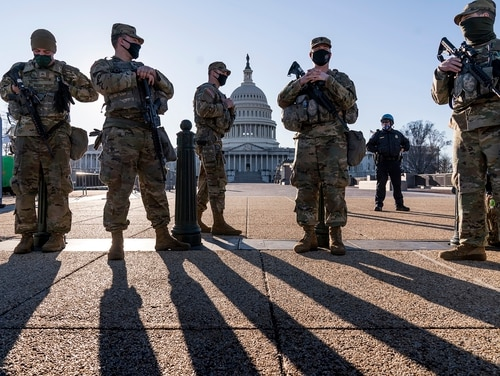Members of the Michigan National Guard and the U.S. Capitol Police keep watch over the Capitol grounds on March 3, 2021. (J. Scott Applewhite/AP)