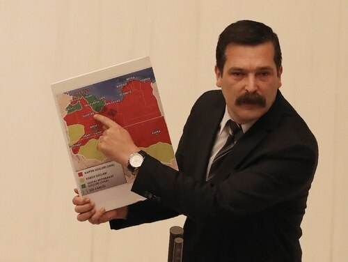 Erkan Bas, a lawmaker of the opposition Workers' Party, shows a map of divided Libya before Turkey's parliament authorized the deployment of troops to Libya to support the U.N.-backed government in Tripoli battle forces loyal to a rival government that is seeking to capture the capital, in Ankara, Turkey, on Thursday. (Burhan Ozbilici/AP)