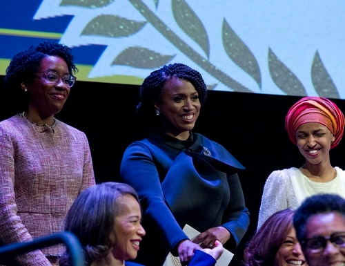 From left, Lauren Underwood D-IL, Ayanna Pressley, D-Mass., and Ilhan Omar D-MN, during the swearing-in ceremony of Congressional Black Caucus members of the 116th Congress at The Warner Theatre in Washington, Thursday, Jan. 3, 2019. (Jose Luis Magana/AP)