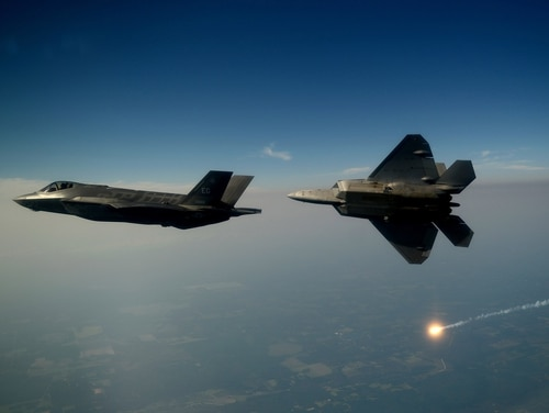 An F-35A from the 33rd Fighter Wing at Eglin Air Force Base in Florida, and an F-22A Raptor from the 43rd Fighter Squadron at Tyndall Air Force Base in Florida, fly together for the first time in 2012. (Master Sgt. Jeremy Lock/Air Force)