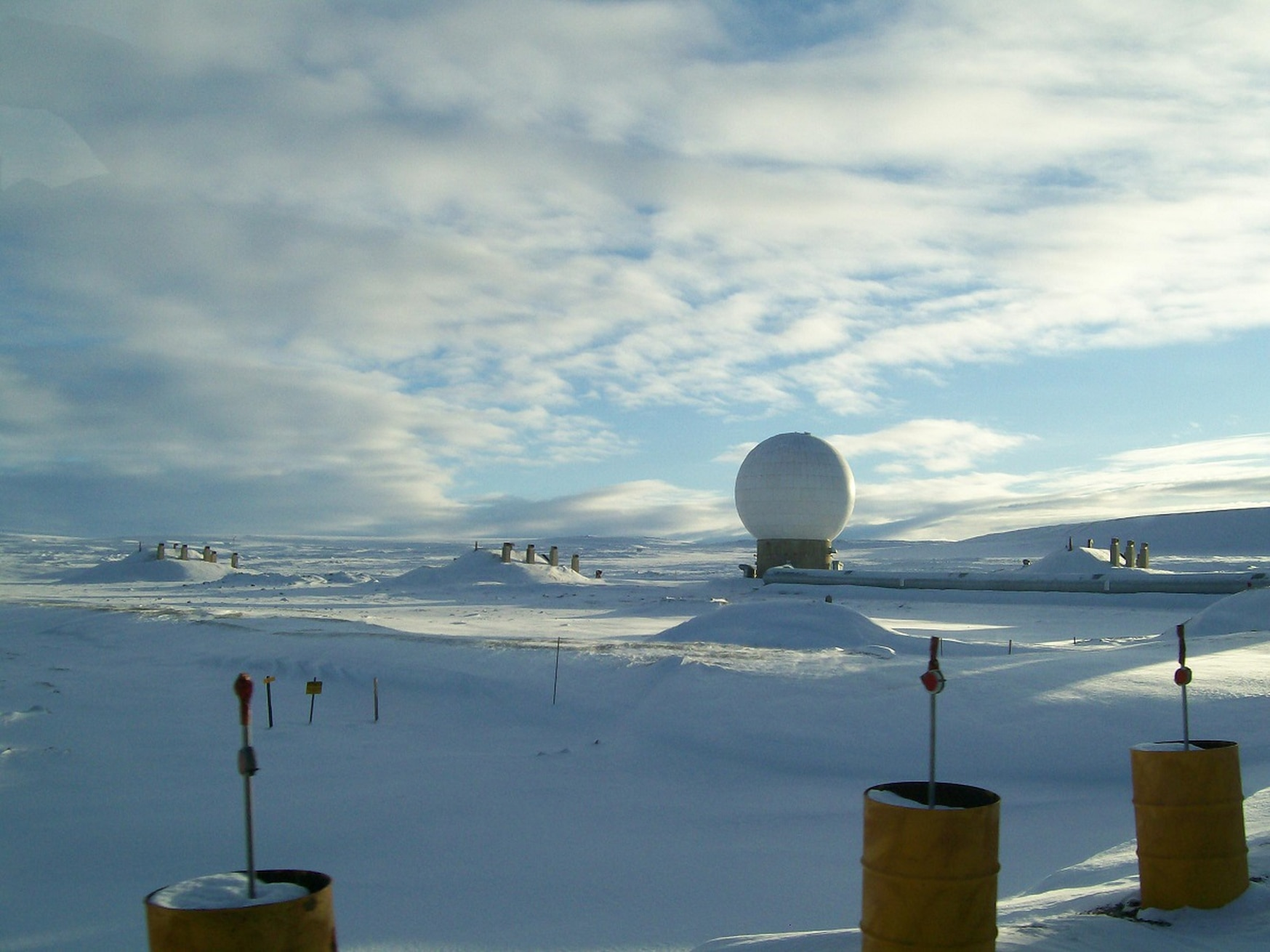 This white golf ball-like structure houses one of several radars that scan the skies for foreign military rockets and missiles at Thule Air Base, Greenland. (JoAnne Castagna/U.S. Army)