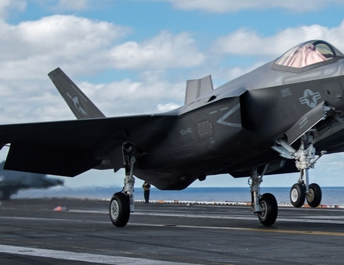 An F-35C Lightning II performs a touch-and-go on the flight deck of the aircraft carrier Carl Vinson. The Pentagon is considering revisions to how it classifies aviation mishaps across the services. (MC3 Ethan Soto/Navy)