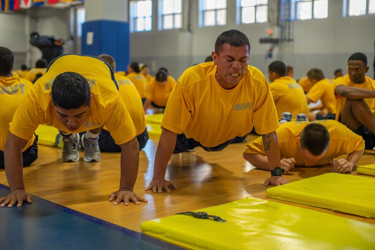 Two recruits struggle to complete their push-ups during the final physical  fitness assessment of boot camp. Recruits must pass in order to graduate. 6e4d7fcb5d