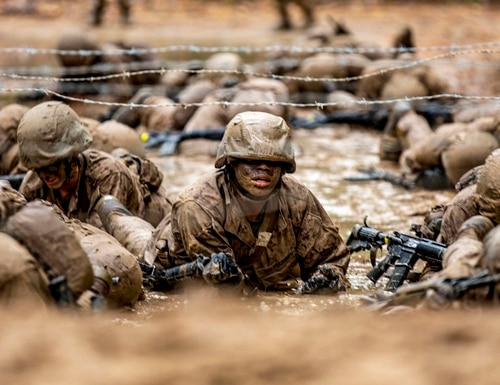 Recruits with November Company, 4th Recruit Training Battalion, work together to move as a fire team through events during the Crucible on Marine Corps Recruit Depot Parris Island, S.C., Dec 3, 2020. (Sgt. Dana Beesley/Marine Corps)