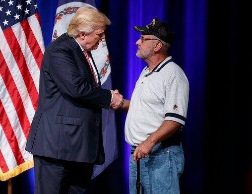 Republican presidential candidate Donald Trump shakes hands with Louis Dorfman, after Dorfman gave him his Purple Heart medal, during a campaign rally at Briar Woods High School, Tuesday, Aug. 2, 2016, in Ashburn, Va. (AP Photo/Evan Vucci)