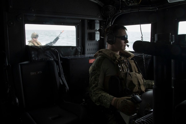 Electronics Technician 3rd Class Matthew Malay, from Worcester, Massachusetts, right mans the aft MK50 Stabilized Small Arms Mount on a Mark VI patrol boat. (Navy photo by MC2 Cat Olaes)