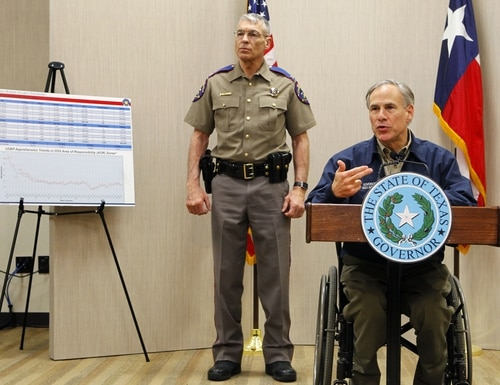 Texas Governor Greg Abbott talks about his border security plan during a news conference as Texas Department of Public Safety Director Steve McCraw stands behind him Friday, March 27, 2015 at DPS' Region 3 Headquarters in Weslaco, Texas. Abbott remains noncommittal on a timeline for pulling the National Guard off the Texas-Mexico border after hundreds of police officers applied for jobs to effectively replace those troops. (AP Photo/The Monitor, Nathan Lambrecht) MAGS OUT; TV OUT