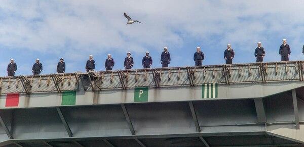 Sailors man the flight deck as the aircraft carrier Harry S. Truman comes alongside Pier 14 in Norfolk. (Mark D. Faram/Staff)
