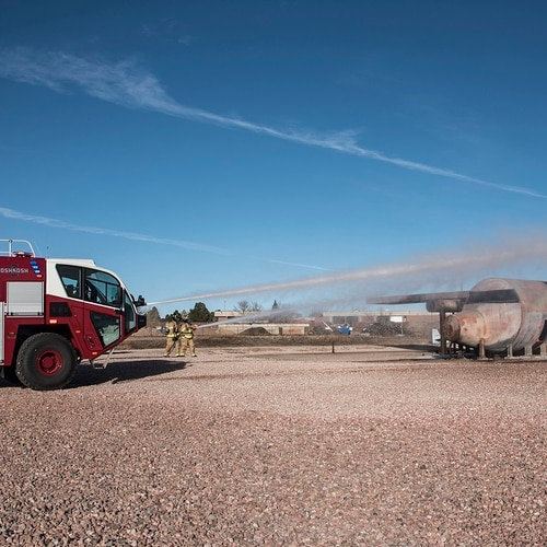 Members of the Peterson Fire Department simulate an aircraft fire during training at Peterson Air Force Base, Colorado, in 2015. (Senior Airman Tiffany DeNault/Air Force)