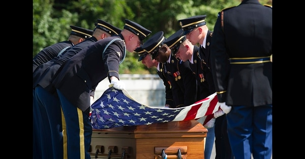 The 3rd Infantry Regiment casket teams stretch the American flag over the casket containing the remains of one of two unknown Civil War Union soldiers to their grave at Arlington National Cemetery in Arlington, Va., Thursday, Sept. 6, 2018. (Cliff Owen/AP)