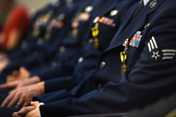 "Five remote ""R"" device recipients sit during their presentation ceremony July 11, 2018, at Creech Air Force Base, Nevada. Their selection was based on stringent criteria, including strategic significance, protection of ground forces, leadership displayed, critical thinking, level of difficulty and innovation. (Senior Airman James Thompson/Air Force)"