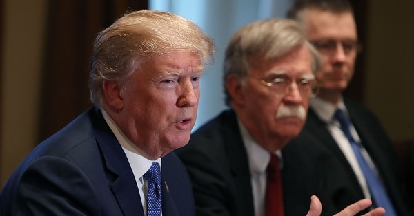 U.S. President Donald Trump is flanked by National Security Advisor John Bolton as he speaks about the FBI raid at his lawyer Michael Cohen's office, while receiving a briefing from senior military leaders regarding Syria, in the Cabinet Room, on April 9, 2018, in Washington, D.C. (Mark Wilson/Getty Images)