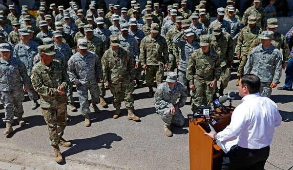 Arizona Gov. Doug Ducey speaks to Arizona National Guard soldiers prior to deployment to the Mexico border at the Papago Park Military Reservation Monday, April 9, 2018, in Phoenix. (Ross D. Franklin/AP)