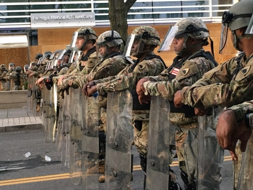 Members of the D.C. National Guard line up near the intersection of 16th Street N.W. and K St. preparing for protestors. Howard Altman photo.