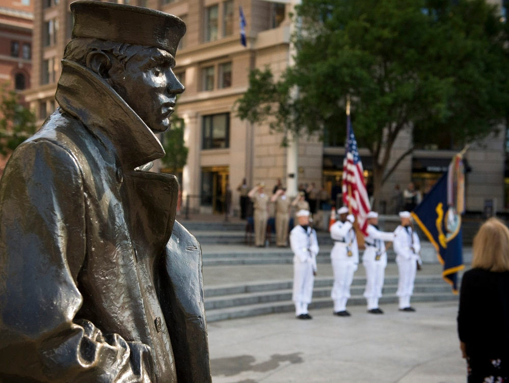 150514-N-AT895-055 WASHINGTON (May 14, 2015) The lone Sailor statue watches over the Navy Memorial during the Sailor of the Year pinning ceremony. 2014 Sailors of the Year Steel Worker 1st Class Brenton W. Heisserer, representing U.S. Navy Shore, Construction Mechanic 1st Class Jimie Bartholomew, representing U.S. Navy Reserve, Logistics Specialist 1st Class Blanca A. Sanchez, representing U.S. Pacific Fleet and Boatswain's Mate 1st Class Joe A. Mendoza, representing U.S. Fleet Forces, were meritoriously advanced to chief petty officer. (U.S. Navy photo by Mass Communication Specialist 1st Class Nathan Laird/Released)