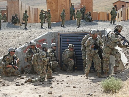 Soldiers from the 33rd Infantry Brigade Combat Team, Illinois Army National Guard, and the 25th Infantry Regiment, Japan Ground Self-Defense Force, conduct an urban assault drill during Rising Thunder 19 at Yakima Training Center, Yakima, Washington. (Sgt. Camacho Roberts/Army)