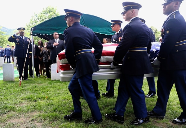 Superintendent Darryl Williams, back left, salutes as the Military honor guard carry the casket of West Point Cadet Christopher J. Morgan, during the interment ceremony at West Point, N.Y., Saturday, June 15, 2019. (Mark Vergari/The Journal News via AP)