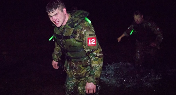 Soldiers jumped at night from a helicopter into cold water and swam several hundred meters to shore during the Best Sapper Competition. 1st Lt. Scott Warner, a combat engineer, emerges from the water. It wasn't exactly swimming weather. (Courtesy Mac Warner)