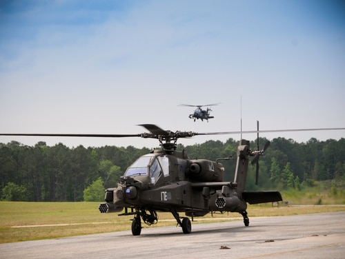 An AH-64 Apache helicopter taxis into the parking area at Ech Stagefield, Fort Rucker, Ala.,, in May 2013. (Sgt. 1st Class Andrew Kosterman/Army)