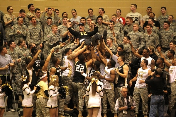 Feb 8, 2014; West Point, NY, USA; Retired Army colonel Daniel Ragsdale (12) leads a cheer with West Point cadets during the first half at Christl Arena. Mandatory Credit: Danny Wild-USA TODAY Sports