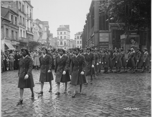 Members of the 6888th Central Postal Directory Battalion take part in a May 27, 1945, parade ceremony in honor of Joan d'Arc at the marketplace where she was burned at the stake. (National Archives)