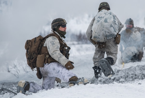 U.S. Marines with Marine Rotational Force Europe 21.1 (MRF-E), Marine Forces Europe and Africa, rush to an objective during a company live-fire attack as part of Exercise Arctic Littoral Strike in Blåtind, Norway, March 30, 2021. Exercise Arctic Littoral Strike improved MRF-E's ability to confront the challenges of anti-access, area denial capabilities posed by a notional peer adversary in a contested littoral environment. MRF-E demonstrated the ability to support joint fleet operations by providing over watch to a Norwegian submarine and destroying a notional adversary integrated air defense system. MRF-E focuses on regional engagements throughout Europe by conducting various exercises, arctic cold-weather and mountain warfare training, and military-to-military engagements, which enhance overall interoperability of the U.S. Marine Corps with allies and partners. (U.S. Marine Corps photo by Cpl. Jesse Carter-Powell)