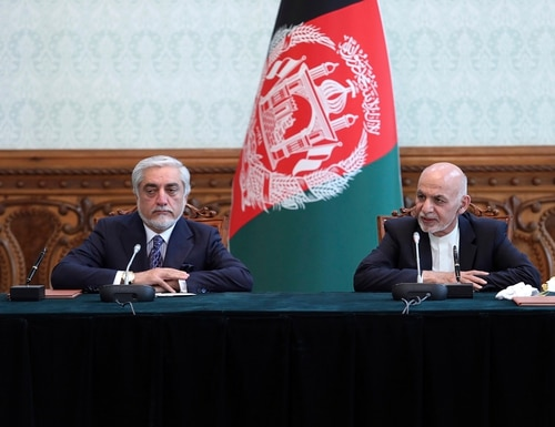Afghan President Ashraf Ghani, right, and political rival Abdullah Abdullah, speak after they signed a power-sharing agreement at the presidential palace in Kabul, Afghanistan, Sunday, May 17, 2020. (Afghan Presidential Palace via AP)