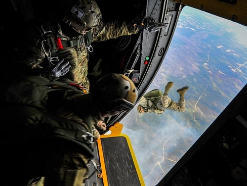 Special tactics airmen from the 24th Special Operations Wing jump out of an MC-130H Combat Talon II at Hurlburt Field, Fla., in January 2015. (Senior Airman Christopher Callaway/Air Force)