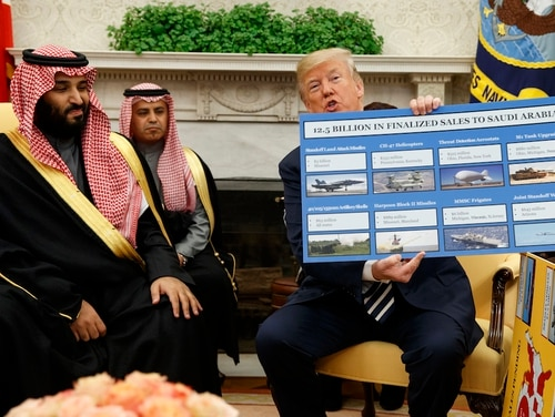 President Donald Trump shows a chart highlighting arms sales to Saudi Arabia during a meeting with Saudi Crown Prince Mohammed bin Salman in the Oval Office of the White House on March 20, 2018, in Washington. (Evan Vucci/AP)