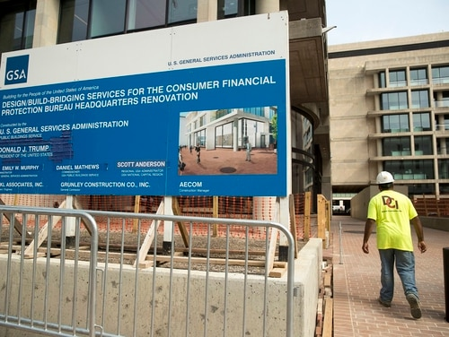 A sign stands at the construction site for the Consumer Financial Protection Bureau's new headquarters in Washington, Monday, Aug. 27, 2018. The CFPB will no longer pursue renaming itself the