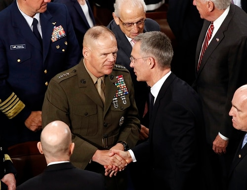 Then-Marine Corps Commandant Gen. Robert Neller, left, speaks with NATO Secretary-General Jens Stoltenberg after Stoltenberg addressed a joint meeting of Congress on Capitol Hill in Washington, April 3, 2019. (Patrick Semansky/AP)