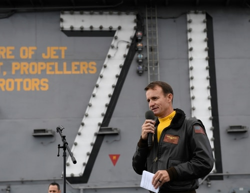 Capt. Brett Crozier, former commanding officer of the aircraft carrier USS Theodore Roosevelt, addresses the crew during an all-hands call on the ship's flight deck. in November. (MC3 Nicholas Huynh/Navy)