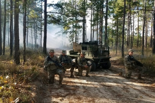 Soldiers at Fort Benning, Georgia, work with a Project Origin experimental Robotic Combat Vehicle during a Soldier Touchpoint in November. (Army)
