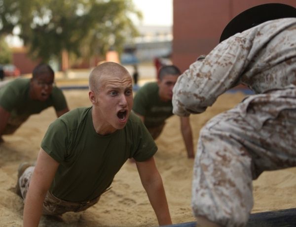 Rct. Graeson Calnan, Platoon 3004, Mike Company, 3rd Recruit Training Battalion, responds to commands during an incentive training session Oct. 30, 2013, on Parris Island, S.C. Incentive training consists of physical exercises administered in a controlled and deliberate manner and is used to correct minor disciplinary infractions. Calnan, 18, from Slate Hill, N.Y., is scheduled to graduate Jan. 17, 2014. Parris Island has been the site of Marine Corps recruit training since Nov. 1, 1915. Today, approximately 20,000 recruits come to Parris Island annually for the chance to become United States Marines by enduring 13 weeks of rigorous, transformative training. Parris Island is home to entry-level enlisted training for 50 percent of males and 100 percent of females in the Marine Corps. (Photo by Cpl. Caitlin Brink)