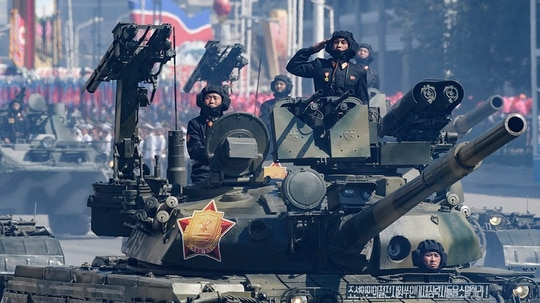 Korean People's Army (KPA) soldiers stand atop armored vehicles during a military parade on Kim Il Sung square in Pyongyang on September 9, 2018. - North Korea held a military parade to mark its 70th birthday, but refrained from showing off the intercontinental ballistic missiles that have seen it hit with multiple international sanctions. (ED JONES/AFP/Getty Images)