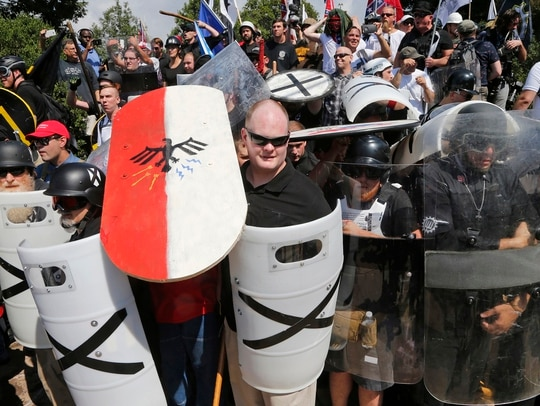 White nationalist demonstrators use shields as they guard the entrance to Lee Park in Charlottesville, Virginia, during an Aug. 12, 2017, protest (Steve Helber/AP)