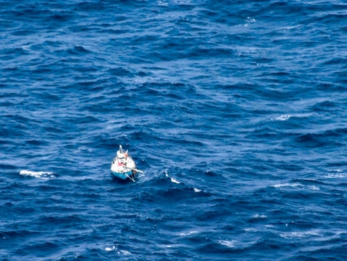 In this photo provided by the Australian Maritime Safety Authority on Monday, the distressed yacht, Thuriya, with Indian sailor Abhilash Tomy on board, floats in the southern Indian Ocean. Tomy was injured and his yacht lost its mast in a storm on Friday. (AMSA via AP)
