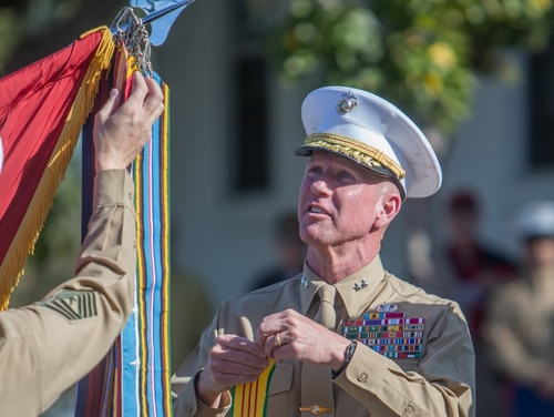 Marine Corps Maj. Gen. Eric Smith, the commanding general of 1st Marine Division, holds a Vietnam service streamer during the unit's 77th anniversary ceremony at Marine Corps Base Camp Pendleton, California, Feb. 2. (Lance Cpl. Roxanna Gonzalez/Marine Corps)